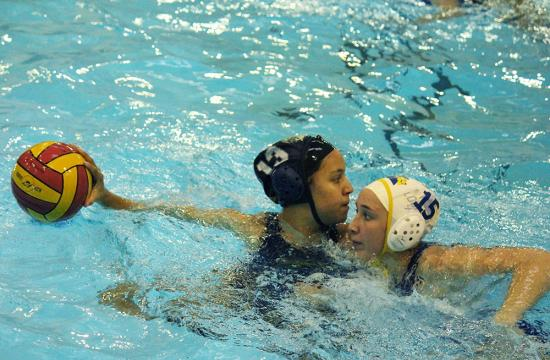 Samohi Girls Waterpolo shooter and captain Jessie Espera (left) looks past the defense of Louisville High School while planning a course of attack.  Espera scored five goals during the Vikings victory 8-6 over the Royals on Wednesday
