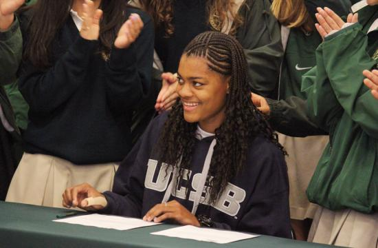 St. Monica High School senior Melissa Maragnes smiles after signing a letter of intent to play at the University of California Santa Barbara during a ceremony at St. Monica High School Friday afternoon.  Maragnes is a forward for the Lady Mariners basketball team.