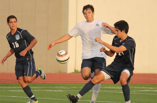 Samohi forward Keone Kojin works his way past Pablo Hernandez of the Crescent Valley Falcons Tuesday