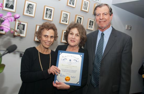 SMC Board of Trustees Chair Nancy Greenstein (left) presents a Certificate of Appreciation to Santa Monica attorneys Sonya and Bruce Sultan for arranging an $807