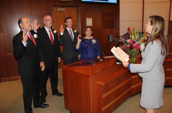 City Clerk Sarah Gorman administers the oath of office Tuesday night to the four City Council members elected Nov. 6. After the ceremony