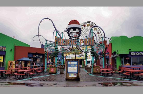 Pacific Park tops its iconic Inkie entryway structure with Southern California's largest Santa Claus hat.