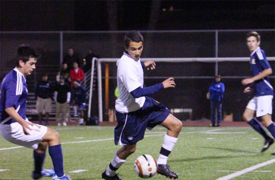 Samohi middle fielder Omar Sanchez makes a move against the Torrence defense at home Thursday night.