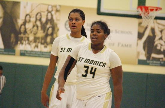 Lady Mariners Basketball point leaders Melissa Maragnes (left) and Briana Harris (right) walk off the court during the St. Monica Tournament on Dec. 4.