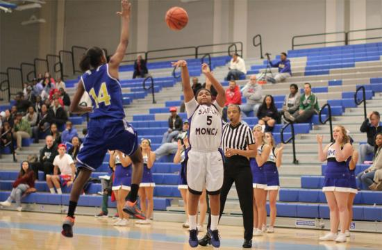 SMC guard Aniese Palmore sinks a three-point shot over West LA's Jade Neal with 2.8 seconds left to play in the second half to put the Corsairs within two points at home Saturday afternoon.