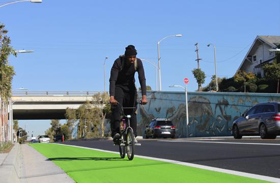"A bicyclist takes advantage Ocean Park Boulevard's ""Green Street"" that runs between Lincoln Boulevard and Nielsen Way."