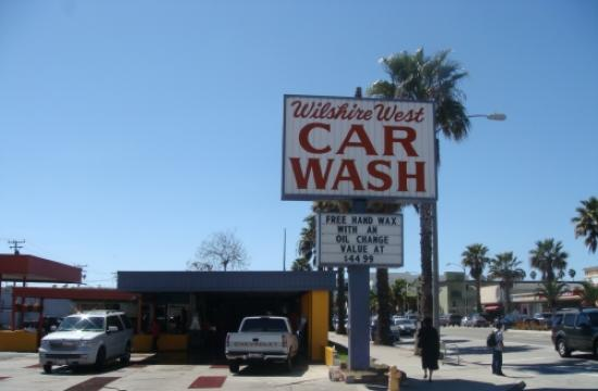 The owners of Wilshire West Car Wash and its management are charged with criminal conspiracy and grand theft.