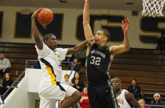 Vikings shooting guard Jordan Matthews looks to draw a foul out of Inglewood's Charlie Lockwood in overtime at home Monday