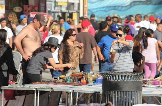 People shop for arts and crafts along the Venice Beach boardwalk May 28