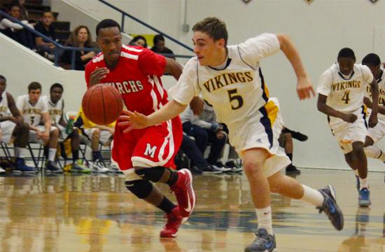Santa Monica High School's Ray Mancini steals the ball from Morningside's Deron Thomas at home Tuesday night.