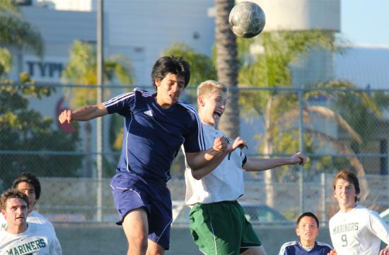Mariners forward Jack Cain (right) goes up for the ball against Lennox Academy's Jose Plascencia (left) during the CIF Southern Section Quarterfinals at Airport Park Friday afternoon.   The Mariners lost to the Panthers 2-0.