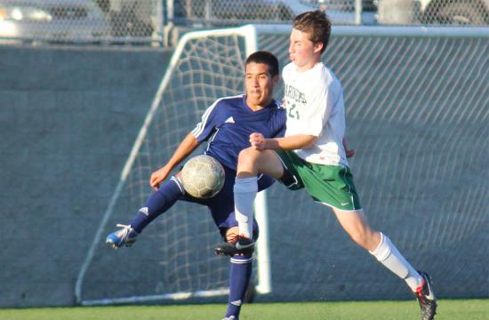 St. Monica's James Tidball (right) takes on Lennox Academy's Aaron Avila (left) in the CIF Southern Section Quarterfinals at Airport Park Friday afternoon. Lennox Academy won the game 2-0.