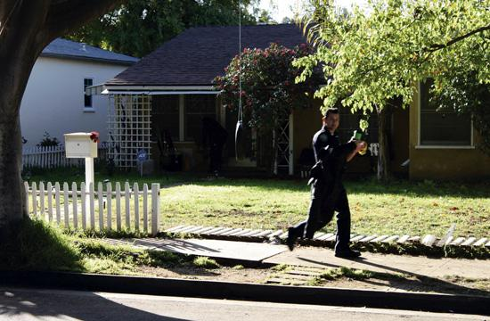 Santa Monica Police Department homicide detectives outside the Delaware Avenue home on Wednesday morning where the hostage situation took place the night before.