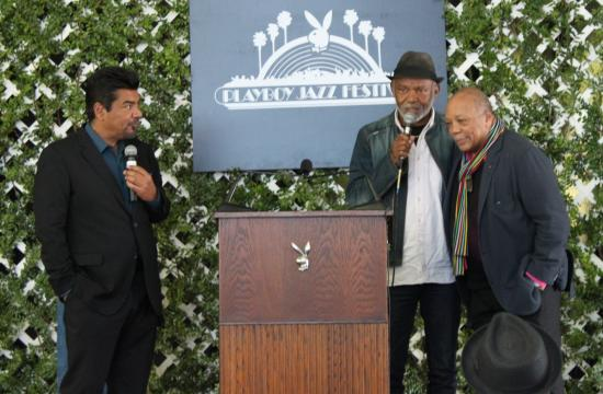George Lopez (left) will star as emcee of the 2013 Playboy Jazz Festival in June. He is pictured on stage with Hubert Laws and Quincy Jones at the line-up announcement held Feb. 28.