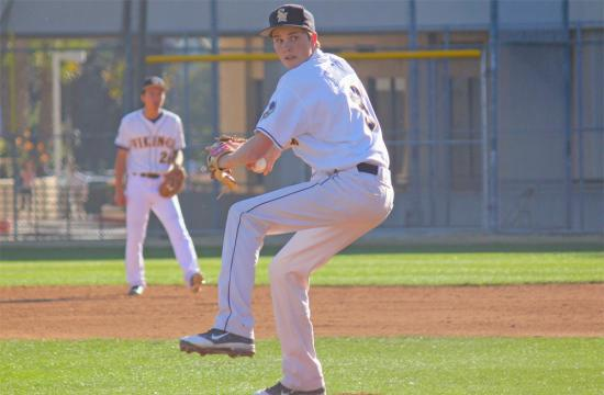 Santa Monica High School pitcher Alex Gironda winds up against the Buena Bulldogs Friday afternoon.  The Vikings won the game 1-0.