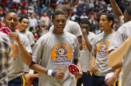 The Santa Monica High School Basketball team celebrates after winning the CIF Southern Section Championship Title against El Toro Saturday night.  The Vikings won the game against the Chargers 66-56.