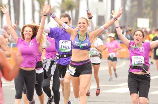 Ultra-marathoner Julie Weiss passes the finish line of the LA Marathon 2013 in Santa Monica Sunday