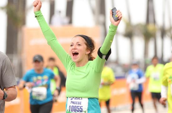 A 2013 Asics LA Marathon runner crosses the finish line in Santa Monica Sunday