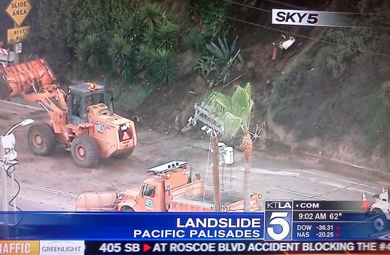 Bulldozers work to remove debris from the Pacific Coast Highway in Pacific Palisades.