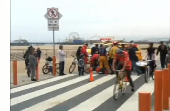 A pedestrian is hit after walking across the bike path without checking for cyclists.