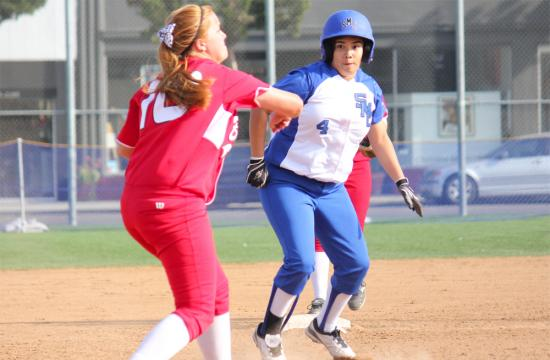 SMC's Cynthia Gamez (center) looks to advance to third base after Bakersfield infielder Brittney Roberts (left) throws the ball to first for an out in the sixth inning.  Gamez would go on to score the third run for the Corsairs at John Adams Middle School field Tuesday afternoon.