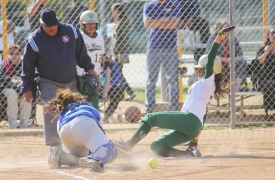 St. Monica's Veronica Navarro slides home in the third inning to beat the tag of Culver City's Lisa Kamba after hitting an inside the park home run.  The home run put the Mariners within one at 5-4 at Veterans Memorial Park in Culver City Wednesday afternoon.
