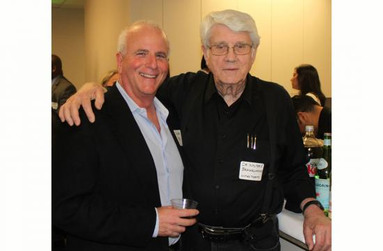 Dr.  Larry Paletz (left) and Dr.  Walter Brackelmanns of UCLA at the WISH open house.
