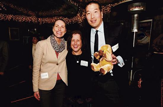 Dr. Paul Song with one of many donated baby items along with two members of the WFHC team.