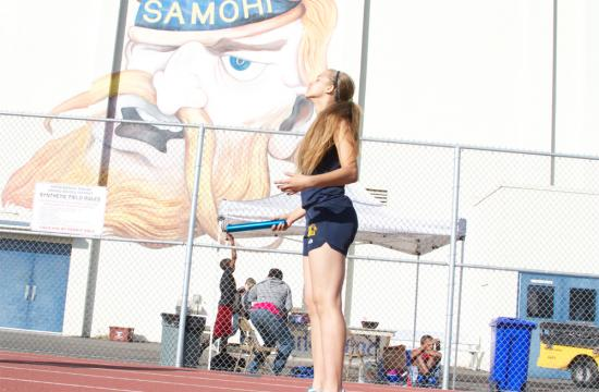 Samohi's Anyssa Smith prepares to run the 4x400 relay at home Thursday afternoon.