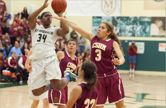 St. Monica's Briana Harris takes a shot against the defense of Cantwell-Sacred Heart in the CIF State Playoffs at home on March 9