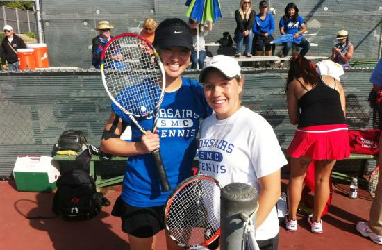 Kaori Tsuda and Juliana Nelkin pose after winning the Western State Conference doubles title for the first time in SMC school history Friday afternoon at Ventura College.