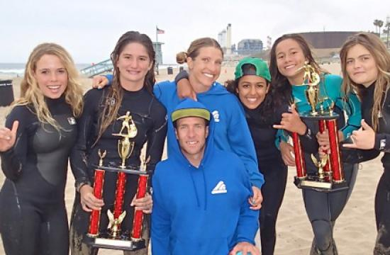 The Santa Monica High School girls surf team pose next to Pier 28 in Santa Monica after ranking first place out of ten schools in Los Angeles/Santa Barbara region of the Scholastic Surf Series (SSS) for the 2012-2013 surf season.