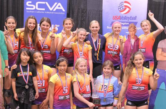 The Sunshine 12 Westside volleyball team pose with their medals after winning the Championship trophy from the Southern California Volleyball Association (SCVA) National Qualifier at the Anaheim Convention Center Sunday afternoon.