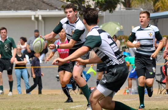 Santa Monica fly-half Cormac Heaney (center left) passes the ball to center Zach Biren in the U16 Dolphins' 17-12 playoff victory over San Clemente at Shorecliffs Middle School in San Clemente Saturday morning.