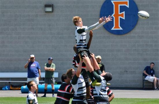 Dolphins flanker Karl Oger skies over the Young Aztecs in the SMRC U16 Boys' 16-15 Southern California Youth Rugby Championships at Cal State Fullerton Saturday afternoon.