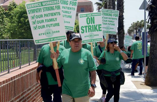 Health care professionals and workers walked the picket line in front of Santa Monica-UCLA Medical Center on Wednesday afternoon. Two unions have been trying to negotiate additional staffing needs at all University of California hospitals but came to an impasse earlier this week.
