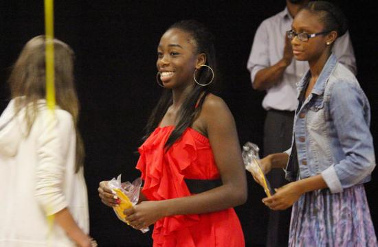 Samohi's Halimat Adeyemi (center) receives her varsity letter along with her teammates during the 2013 Vikings Track And Field awards ceremony at the Moose Lodge in Santa Monica Tuesday night.