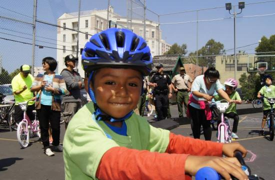 One of the happy Santa Monica Boys and Girls Club members taking a ride.