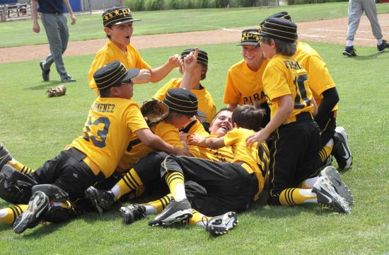 The Pirates dog pile on pitcher Grant Smith (center) after winning the Santa Monica Littlte League crown against the Orioles 9-5 Saturday afternoon at Memorial Park.  Smith was instrumental in the Pirates win over the Orioles.
