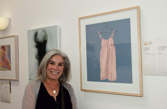 """Contributing artist and CLARE supporter Francine Fanali poses with her work titled """"Pink Slip"""" at the ART for CLARE fundraiser on Sunday."""
