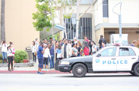 Santa Monica College students wait outside the college after being evacuated due to a shooter on campus Friday afternoon.