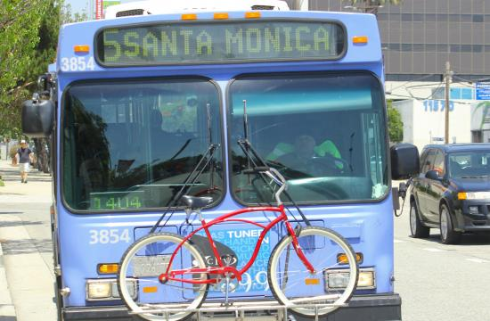 A big blue bus travels to Santa Monica.
