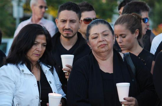 Mourners gather for an evening vigil at Santa Monica College Monday evening at the spot where Marcela Dia Franco and her father Carlos Navarro Franco
