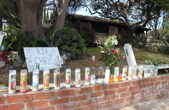 Candles are seen lit Tuesday morning outside the house on the corner of Yorkshire and Kansas in Santa Monica where Friday's shooting rampage began.