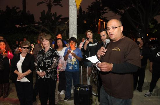 Jaime Cruz addresses the crowd at a vigil held Sunday evening in the Pico neighborhood.