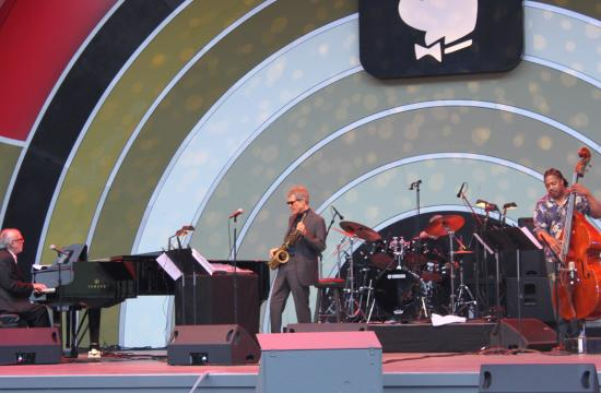 David Sanborn (center) performs with Bob James (left) and James Genus on Sunday