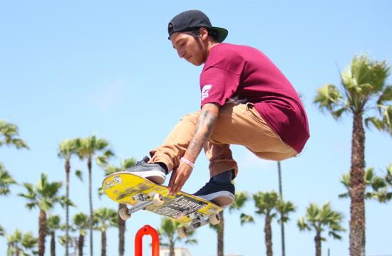 Venice skater Edwin Osario hangs high in the air showing off a sick melon grab after being launched off of the skater bowl at the Venice Beach skate park Wednesday afternoon.  Osario is one of the hundreds of local skaters in the area who will be attending the Go Skateboarding Day event at the Venice Beach skate park Friday afternoon.