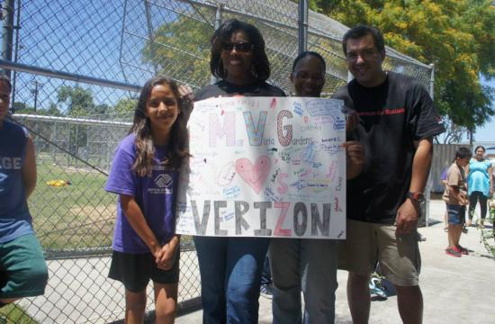 Boys and Girls Club members created a 'thank you' poster for the Verizon volunteers who helped give their tech center a facelift.