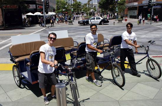 LA Bike Taxi founder Jose Prats (center) with his pedicab drivers Corey Roman and Terrence Kava.