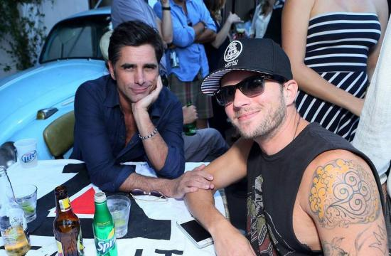 John Stamos and Ryan Phillippe catching up over Voli Light Vodkas and Sprite at the Asphalt Yacht Club launch event at The Malibu Inn on Saturday.